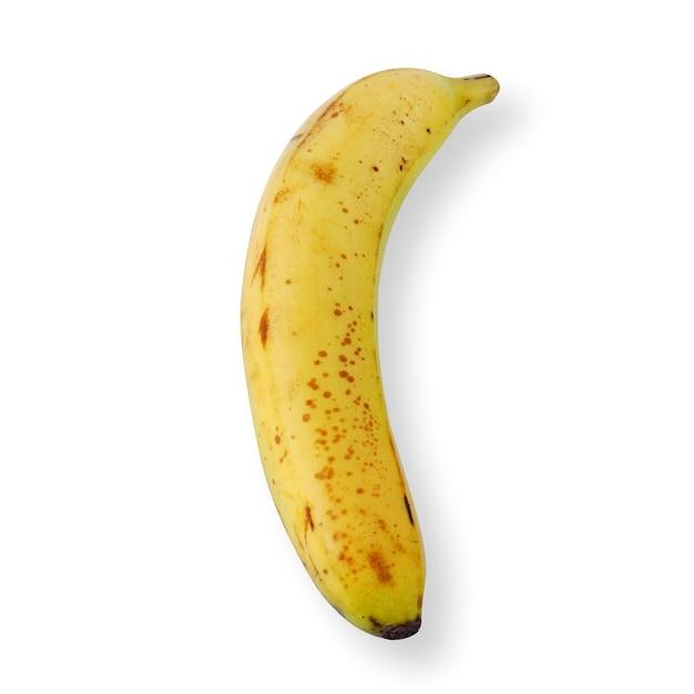 Вид сверху спелого банана с темными пятнами на белом фоне