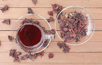 Top view of Roselle juice with dried roselle on wooden plank.