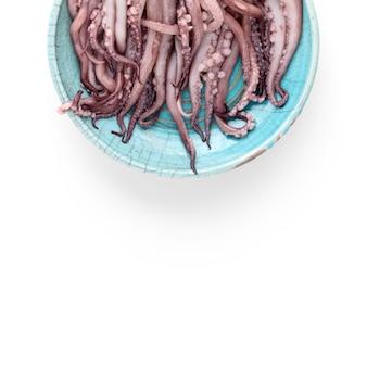 Вид сверху кальмаров на тарелке