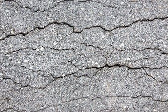 Top view of tarmac pavement showing interesting crack feature