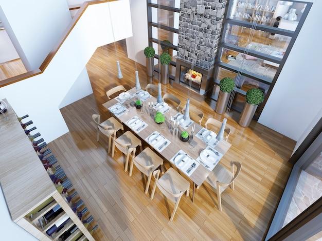 10人のための役立ったテーブルと高い天井のダイニングルームの平面図。