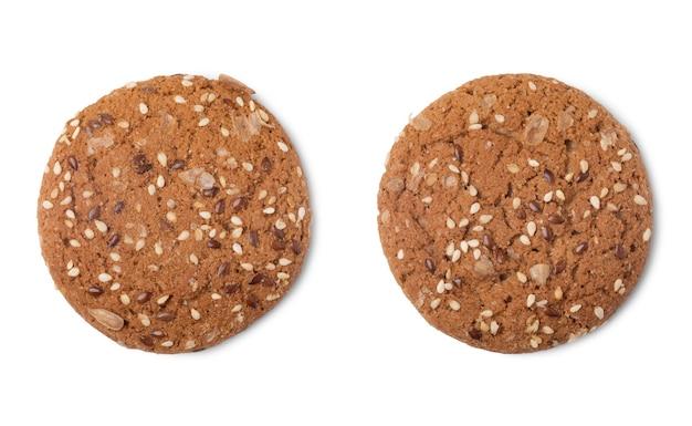 해바라기와 아마 씨 흰색 배경에 고립 된 두 개의 다른 oatcakes의 최고 볼 수 있습니다.