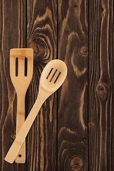 Top view of two different wooden spatulas on table