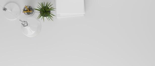 紙鉛筆テーブルランプ植物とコピースペースと白い作業スペースの装飾の上面図