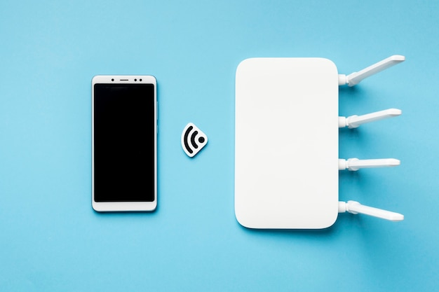 Вид сверху wi-fi роутер со смартфоном