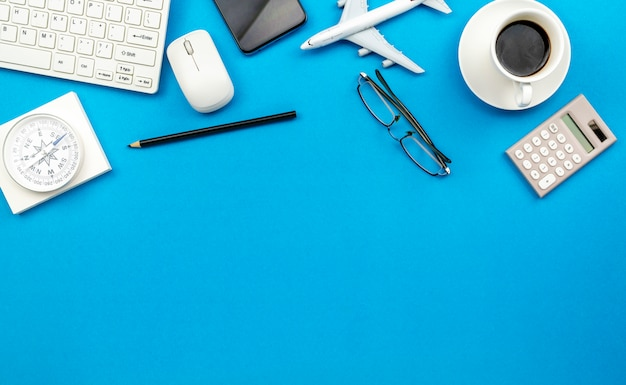 Top view of office desk table of business workplace and business objects on blue background