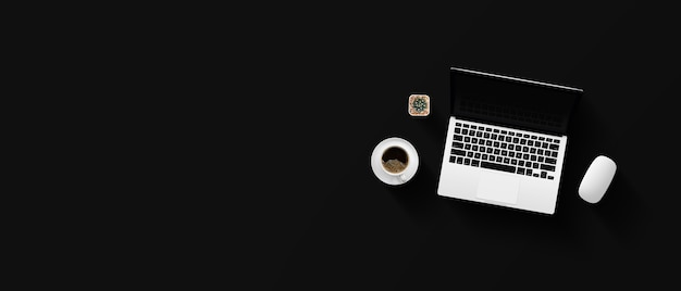 Top view of office desk workspace with coffee cup and laptop on black table