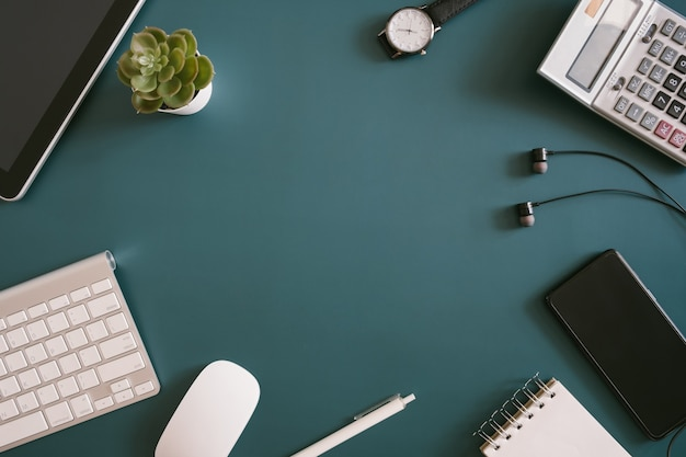 Top view of an office desk workspace