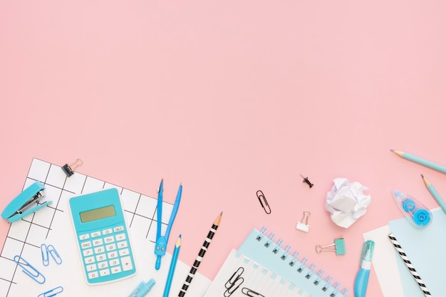 Top view of office stationery with calculator and copy space