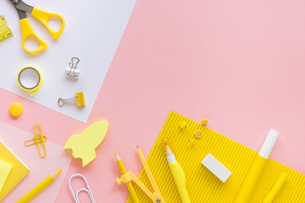 Top view of office stationery with compass and paper clips