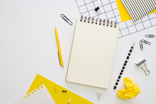 Top view of office stationery with pen and paper clips