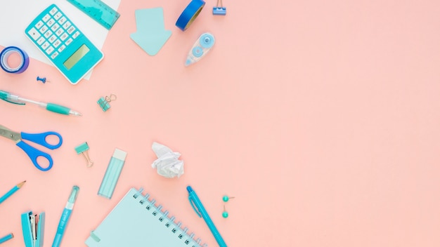 Top view of office stationery with stapler and copy space