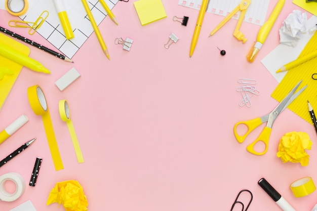 Top view of office stationery with tape and scissors