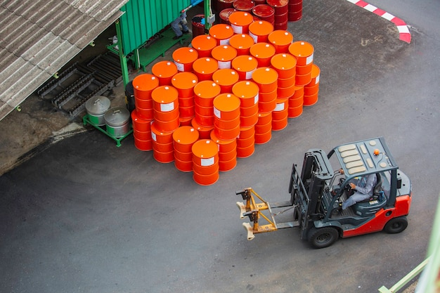 Top view oil barrels forklift truck move for on the transportation truck.