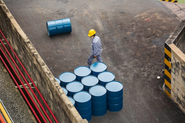 Top view oil barrels vertical move for on the male worker help arrange.