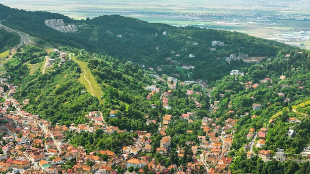 Top view of old brasov city and forest
