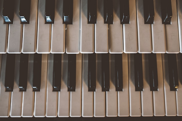 Top view old piano keyboard with old vintage tone