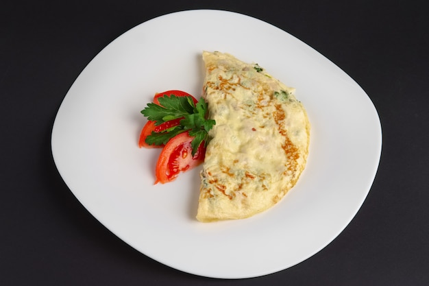 Top view of omelet with ham and vegetables