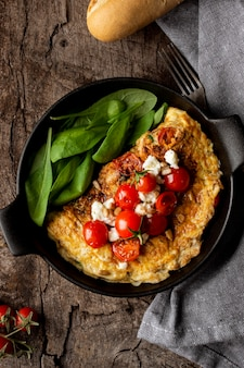 Top view omelette with cherry tomatoes
