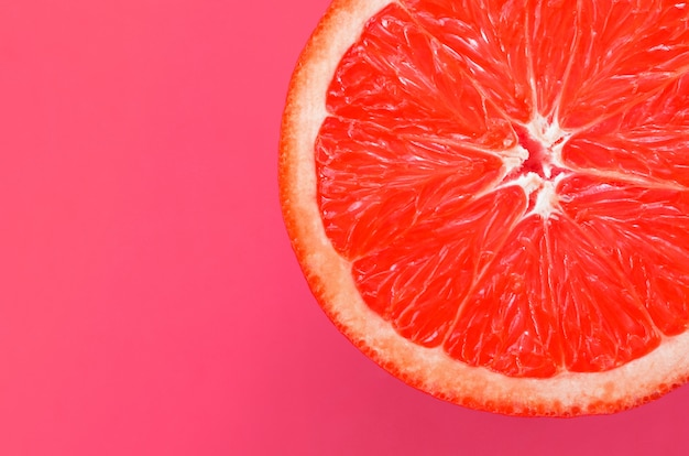 Top view of a one grapefruit slice background
