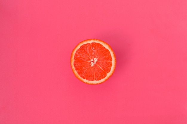 Top view of a one grapefruit slice on background