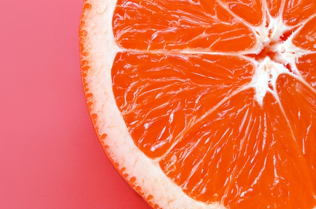 Top view of a one grapefruit slice on bright background