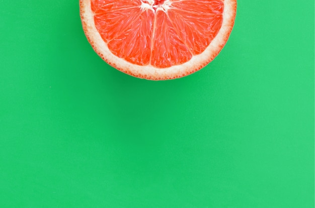 Top view of an one grapefruit slice on bright