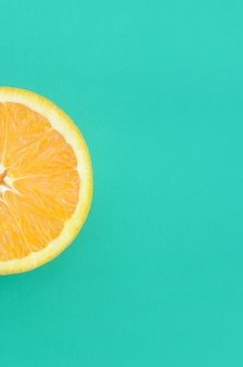 Top view of a one orange fruit slice on bright background