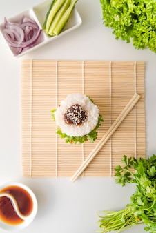 Top view onigiri with vegetables