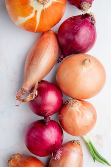 Top view of onions on white background