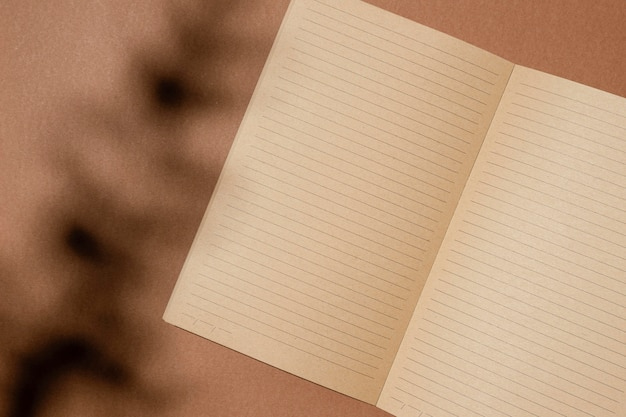 Top view of open brown paper notebook