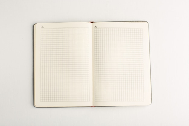 Top view open copybook on white surface