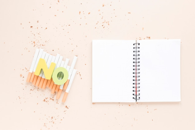 Top view open notebook with cigarettes