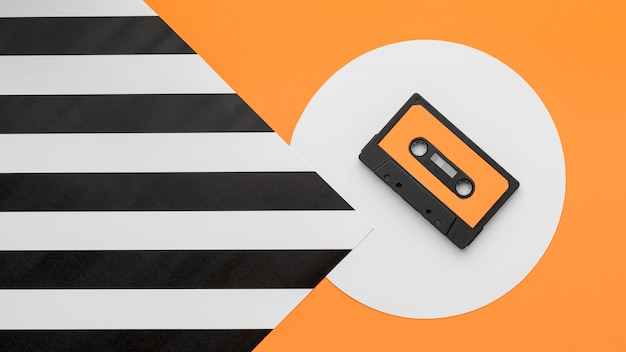 Top view orange and black cassette tape
