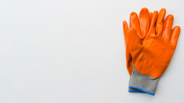 Top view orange gardening gloves