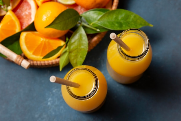Top view orange juice with citrus mix