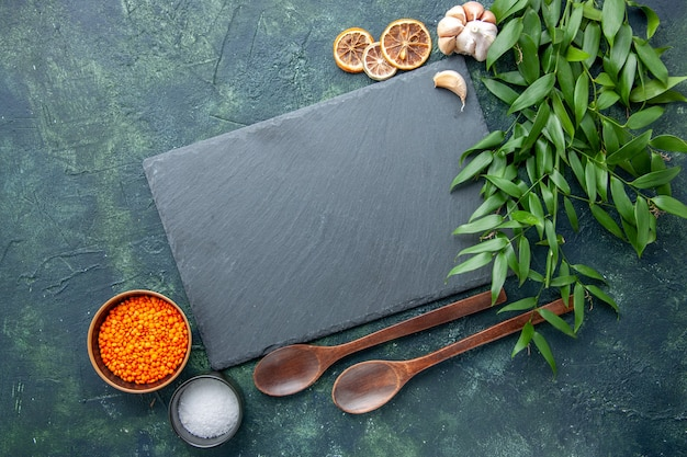 Top view orange lentils with garlic and salt on a dark blue background photo food spicy hot pepper color sharp seed soup
