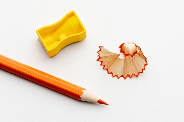 Top view of orange pencil with pencil sharpener