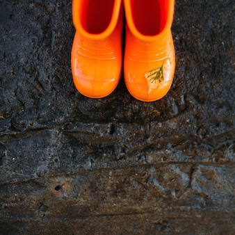 Top view of orange rubber boots.