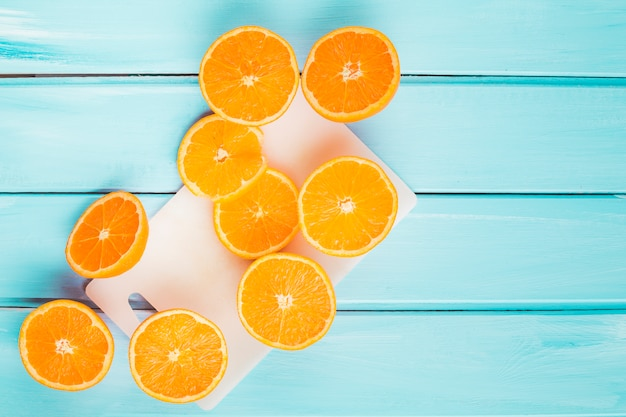 Top view oranges on wooden background