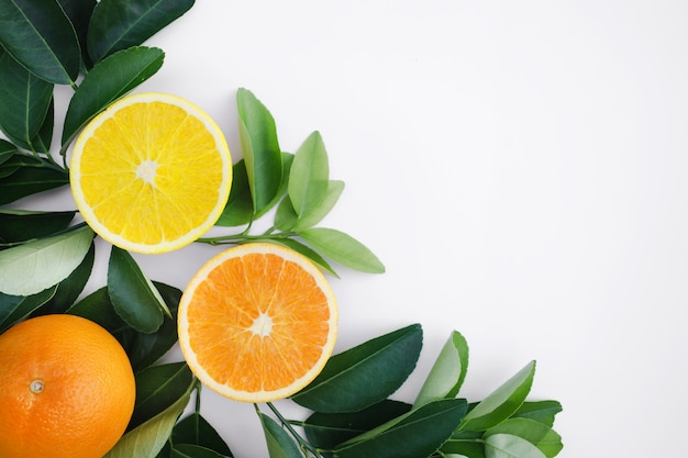 Top view of organge fruit and leaves on teble background