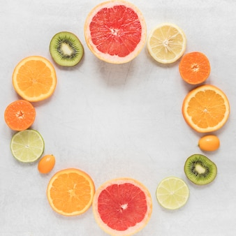Top view organic and fresh slices of fruits