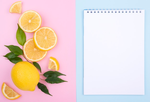 Top view organic lemon with notebook