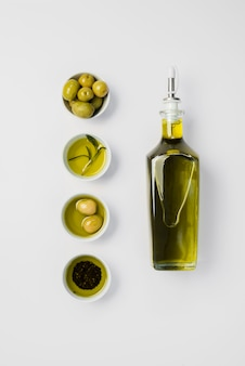 Top view organic olive oil and olives