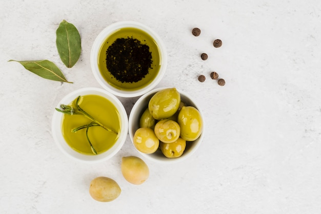Top view organic olives and oil