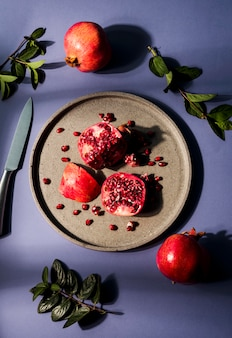 Top view organic pomegranate on plate