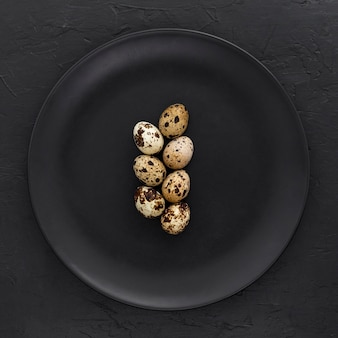 Top view organic quail eggs on a plate