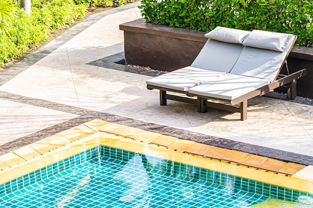 Top of view outdoor swimming pool in resort hotel for leisure relax