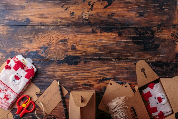 Top view of packing christmas gifts space for text boxes christmas decoration socks craft flat lay of wrapping presents