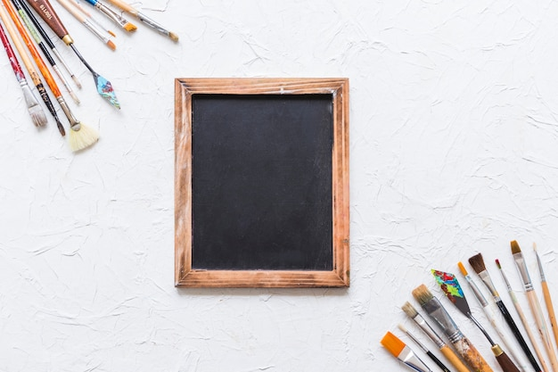 Top view paint brush corners with blackboard
